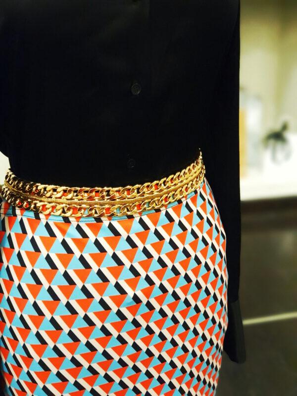 Falda triangulo color naranja azul turqesa negro blanco elastano poliester